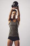 Woman working out with kettle bell Stock Photos