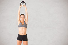 Woman Working Out With a Kettlebell Stock Photo
