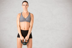 Woman Working Out With a Kettlebell Royalty Free Stock Image