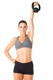 Woman Working Out With a Kettlebell Stock Images