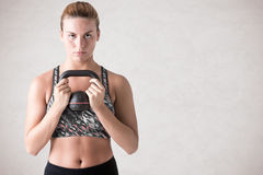 Woman Working Out With a Kettlebell Stock Photography