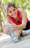 Woman working out at the park Stock Photo
