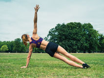 Woman working out in park Stock Photos