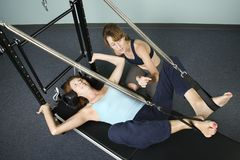 Woman Working Out With Personal Trainer Royalty Free Stock Image
