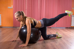 Woman working out with a pilates ball Stock Photography