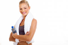 Woman working out. Portrait of beautiful sporty woman after working out holding water bottle Royalty Free Stock Photo