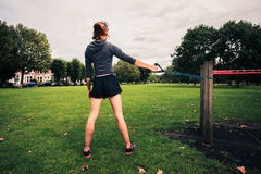 Woman working out with resistance band in the park Stock Photography