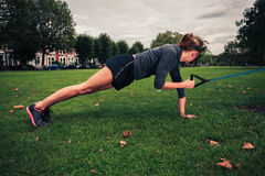 Woman working out with resistance band in the park Royalty Free Stock Photos