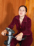 Woman working out on spinning bike Stock Photography