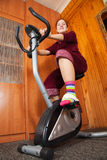 Woman working out  on spinning bike Stock Photo