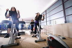 Woman working out on spinning bike at gym Royalty Free Stock Image