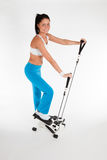 Woman working out on stepper trainer Royalty Free Stock Photography