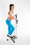 Woman working out on stepper trainer Royalty Free Stock Photo