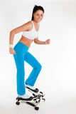 Woman working out on stepper trainer Royalty Free Stock Photos