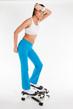 Woman working out on stepper trainer Stock Image