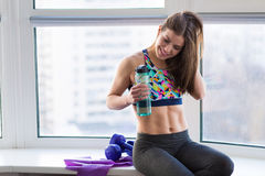 Woman working out in the studio. Beautiful young woman working out in the studio with elastic band Royalty Free Stock Photography