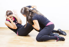 Woman working out with tough personal trainer. Young women working out with tough personal trainer Royalty Free Stock Images