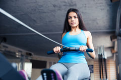 Woman working out on training simulator Stock Images