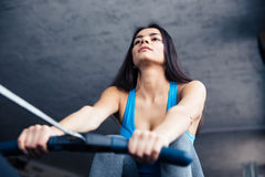 Woman working out on training simulator Stock Image