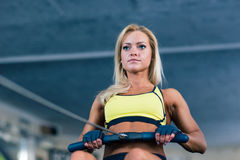 Woman working out on training simulator Royalty Free Stock Images