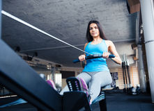 Woman working out on training simulator at gym Royalty Free Stock Photography