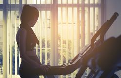 Woman working out on treadmill machine in gym. Woman working out on treadmill machine in fitness gym Stock Image
