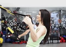 Woman working out with trx bands Royalty Free Stock Photo