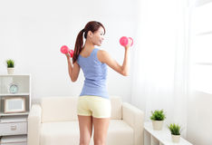 Woman working out with two dumbbells Royalty Free Stock Photo