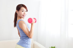 Woman working out with two dumbbells Royalty Free Stock Image