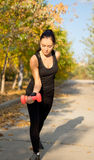 Woman working out with weights Royalty Free Stock Images