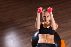 Woman Working Out with Weights and Exercise Ball Royalty Free Stock Photo