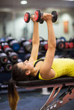 Woman working out with weights Royalty Free Stock Photo