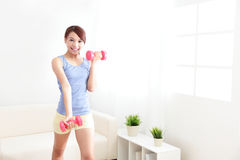 Free Woman Working Out With Two Dumbbells Royalty Free Stock Image - 35011446