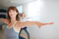 Woman working out in yoga class Stock Photos