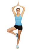 Woman working out yoga excercise Royalty Free Stock Photography