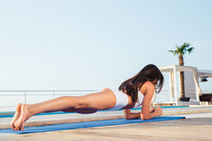 Woman working out on yoga mat Stock Photography