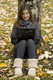Woman working outdoor. Beautiful woman working with a laptop in outdoor Royalty Free Stock Photos