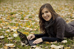 Woman working outdoor. Beautiful woman working with a laptop in outdoor Royalty Free Stock Images