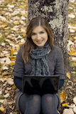 Woman working outdoor. Beautiful woman working with a laptop in outdoor Royalty Free Stock Image
