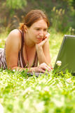 Woman working outdoors. Young woman using her laptop outdoors Stock Photos