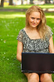 Woman working outdoors Stock Images