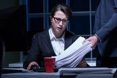 Woman working overtime Stock Photo