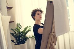 Woman working on a painting Stock Photo