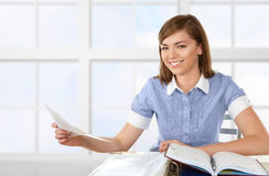 Woman working with papers Royalty Free Stock Photos