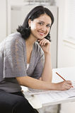 Woman Working on Paperwork Stock Image