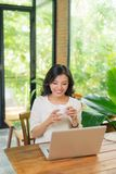 Woman is working on the pc at the internet cafe.  royalty free stock photos