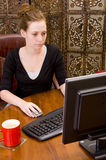 Woman working on PC keyboard Stock Photo