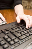 Woman working on PC keyboard and mouse. Stock Photography