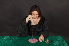 A woman is working with a pendulum Royalty Free Stock Images