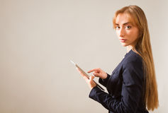 Woman working on a Person Using Device. Royalty Free Stock Image